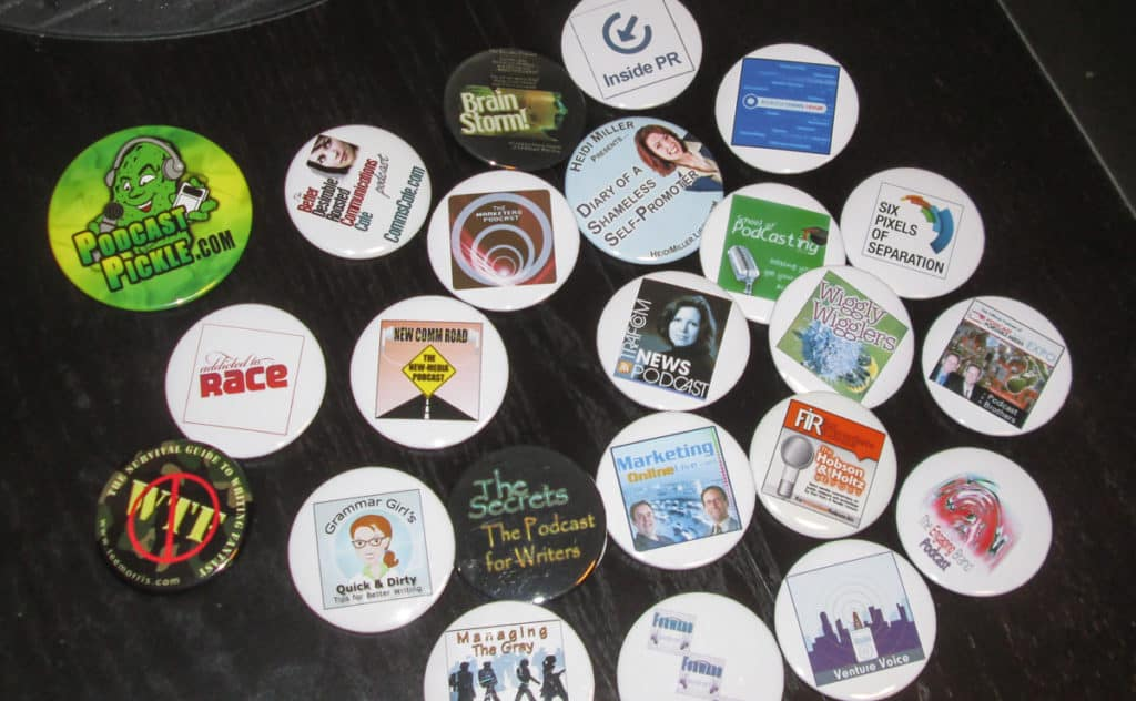 buttons with podcast album art on them, worn to the Podcast Expo